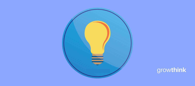 yellow light bulb inside a blue circle